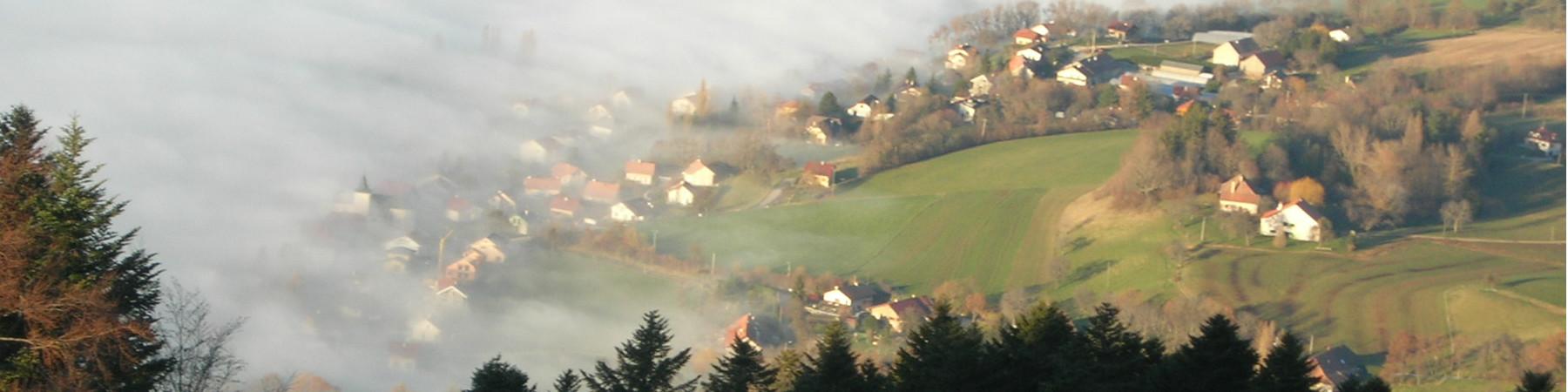Beaumont dans la brume